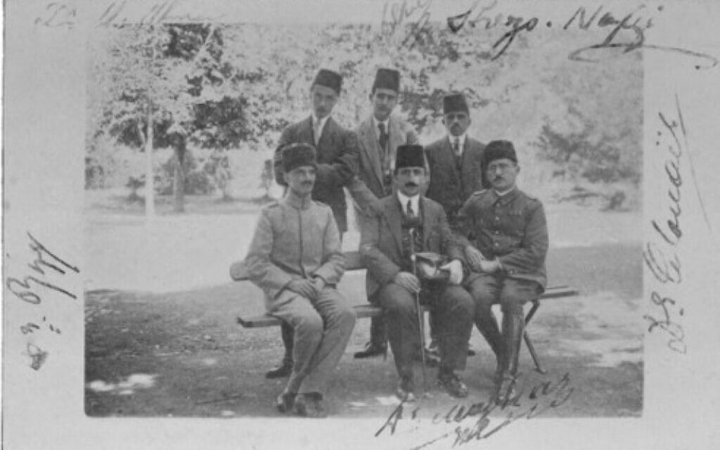 The doctors of the 'mad ward' at Haidar Pasha Hospital. Mazhar Osman Bey, 'the greatest authority on mental diseases in Eastern Europe,' is seated front row center. (Jones, 'The Road to En-Dor,' 1919)