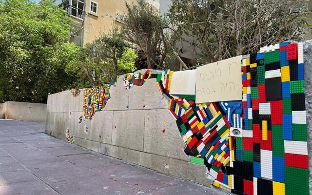 Legos used to repair a wall struck by a Gaza rocket in Ramat Gan on May 15, 2021. (Raz Sror)