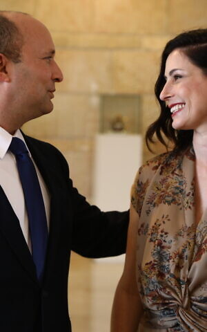 Prime Minister Naftali Bennett with his wife Gilat in the Knesset in Jerusalem, on June 13, 2021. (Ariel Zandberg/Yamina)