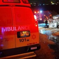 Rescue workers at the scene of a burning vehicle in Jerusalem found a body inside on June 9, 2021 (Magen David Adom)