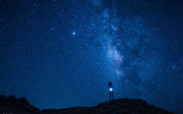 A sky full of stars in Mitzpe Ramon, by Moshe Gold, whose debut photography exhibit opened June 3, 2021 at the Jerusalem Cinematheque (Courtesy Moshe Gold)
