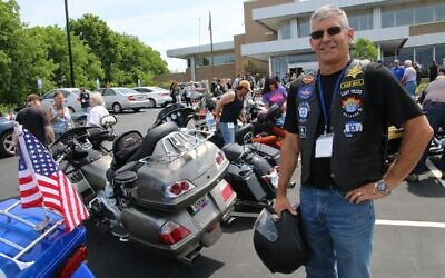 A member of the Lost Tribe motorcycle club displays badges espousing Jewish pride and Holocaust remembrance. (Courtesy Jewish Motorcycle Alliance)