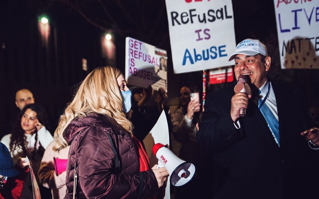 Amber Adler, left, and Heshy Tischler, candidates for New York City Council, attend a rally in Brooklyn, March 21, 2021. The rally was part of a movement to free a woman whose husband refused to grant her a Jewish divorce. (Anna Rathkopf/ via JTA)