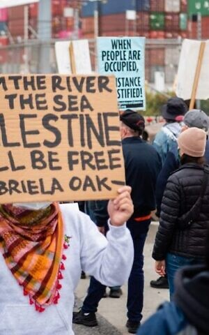 Protesters at the Port of Oakland, where they halted a container ship owned by the Israel-based Zim Integrated Shipping Services Ltd. in a campaign tied to the BDS movement, June 4, 2021. (Brooke Anderson via J: Jewish News of Northern California via JTA)