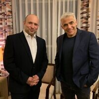 Yamina chief Naftali Bennett and Yesh Atid leader Yair Lapid are seen on Wednesday evening, as they inform President Reuven Rivlin they have succeeded in forming a government, June 2, 2021 (Courtesy)
