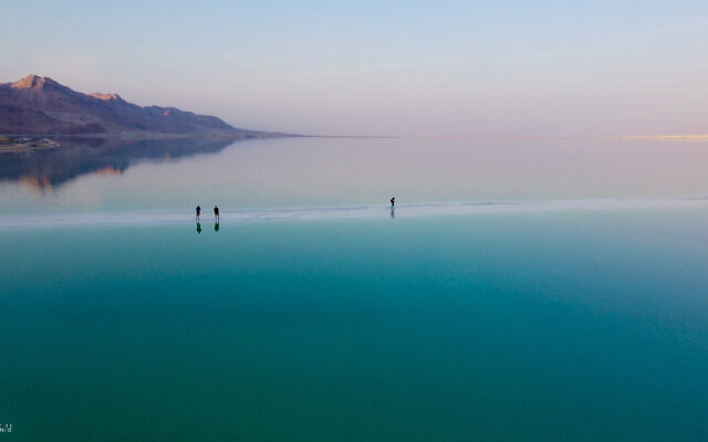 Walking out onto the Dead Sea by Moshe Gold, whose debut photography exhibit opened June 3, 2021 at the Jerusalem Cinematheque (Courtesy Moshe Gold)