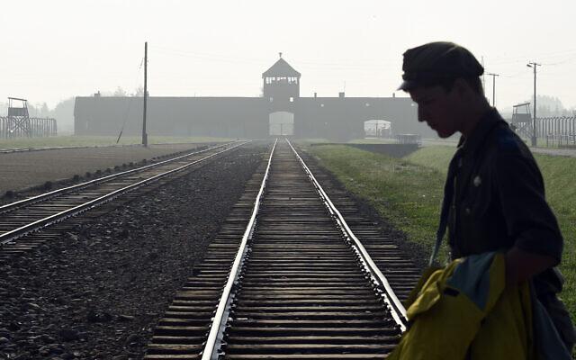 A man crosses the rails at the former Nazi German death camp of Birkenau in Oswiecim, Poland, July 29, 2016. (AP/Alik Keplicz)
