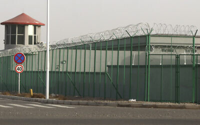 A guard tower and barbed wire fence surround a detention facility in the Kunshan Industrial Park in Artux in western China's Xinjiang region. December 3, 2018. (AP Photo/Ng Han Guan, File)