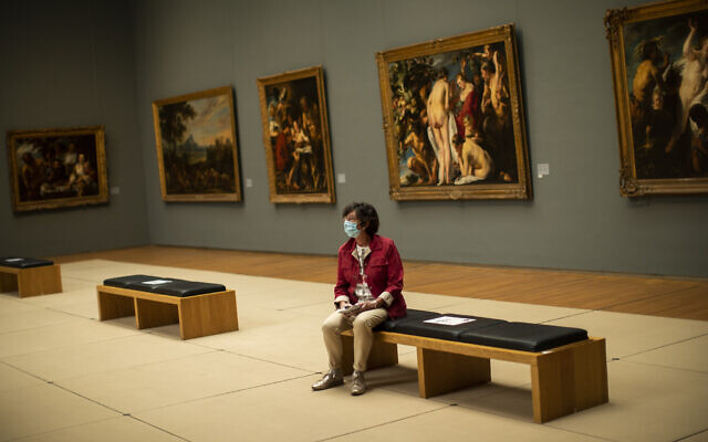Illustrative: A woman wears a face mask, to prevent against the spread of coronavirus, at the Royal Museum of Fine Arts in Brussels, May 19, 2020. (AP Photo/Francisco Seco, File)