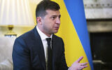 Ukraine President Volodymyr Zelensky, gestures as he talks to Britian's Prime Minister Boris Johnson,  during a meeting, in Downing Street, London, Thursday, Oct. 8, 2020.(Aaron Chown/Pool Photo via AP)
