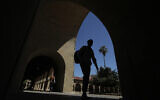 In this April 9, 2019, file photo, pedestrians walk on the campus at Stanford University in Stanford, California (AP Photo/Jeff Chiu, File)