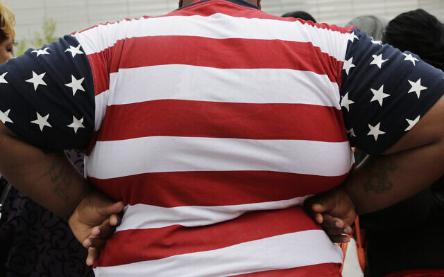 Illustrative: In this May 8, 2014, file photo, an overweight person is seen in New York.  (AP Photo/Mark Lennihan, File)
