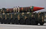 A Pakistani-made Shaheen-III missile, that is capable of carrying nuclear warheads, is carried on a trailer during a military parade in connection with Pakistan National Day celebrations, in Islamabad, Pakistan, March 25, 2021. (Anjum Naveed/AP)