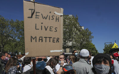 A man holds a placard during a protest organized by Jewish associations, who say justice has not been done for the killing of French Jewish woman Sarah Halimi, at Trocadero Plaza near Eiffel Tower in Paris, April 25, 2021. (AP Photo/Michel Euler)