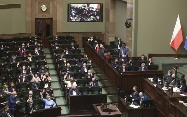 Poland's lawmakers during voting – some in parliament, some remotely – in Warsaw, Poland, on Tuesday, May 4, 2021. (AP Photo/Czarek Sokolowski)