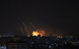 Illustrative: Smoke rises following Israeli missile strikes on Gaza City on May 13, 2021. (AP/Khalil Hamra)