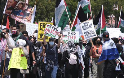 Demonstrators march to the Israeli Consulate during a protest against Israel and in support of Palestinians on May 15, 2021, in the Westwood section of Los Angeles. (AP Photo/Ringo H.W. Chiu)