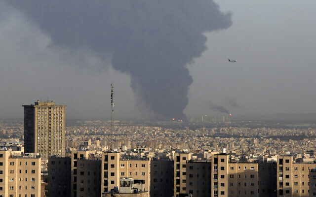 Huge smoke rises up from Tehran's main oil refinery as a plane approaches Mehrabad airport south of Tehran, Iran, June 2, 2021. (AP Photo/Vahid Salemi)