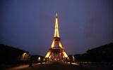 The Eiffel Tower is illuminated in Paris, Tuesday, May 25, 2021. France is putting itself back on the menu as a destination for international tourists who have had coronavirus jabs. (AP Photo/Francois Mori)