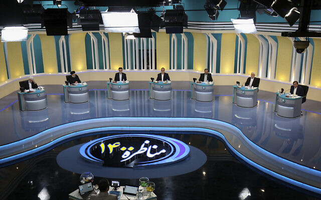 In this photo made available by the government-affiliated Young Journalists Club, presidential candidates, from left, Saeed Jalili, Ebrahim Raisi, Amir Hossein Ghazizadeh Hashemi, Alireza Zakani, Mohsen Rezaei, Mohsen Mehralizadeh, and Abdolnasser Hemmati, participate in a televised debate in a state-run television studio, in Tehran, Iran, on Saturday, June 5, 2021. Elections are scheduled for June 18. (Morteza Fakhri Nezhad/YJC via AP)