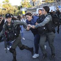 Israeli forces arrest Al Jazeera journalist, Givara Budeiri, during a protest in the east Jerusalem neighborhood of Sheikh Jarrah, June 5, 2021. (AP Photo/Oren Ziv)