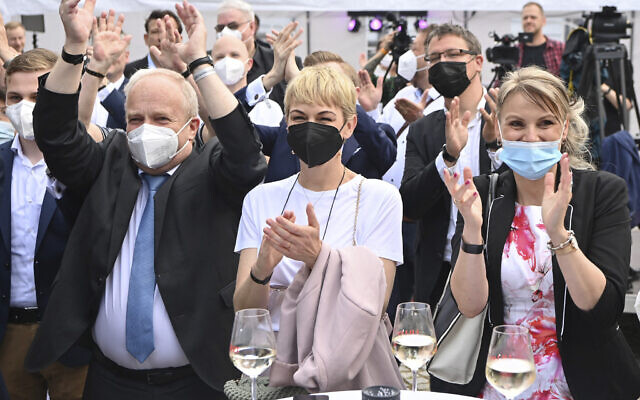 Supporters of Merkel's Christian Democratic Union party, CDU, react after the first exit poll for the Saxony-Anhalt state elections announced in Magdeburg, Germany, June 6, 2021. (Bernd Von Jutrczenka/ dpa via AP)