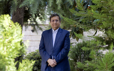 Former Iranian Central Bank chief Abdolnasser Hemmati, a candidate in Iran's upcoming presidential election, poses for a photo at his office in Tehran, Iran, June 9, 2021. (Ebrahim Noroozi/AP)