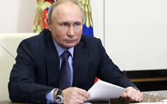 Russian President Vladimir Putin takes part in the launch of Gazprom's Amur Gas Processing Plant via videolink at the Novo-Ogaryovo residence outside Moscow, Russia, Wednesday, June 9, 2021. (Sergei Ilyin, Sputnik, Kremlin Pool Photo via AP)