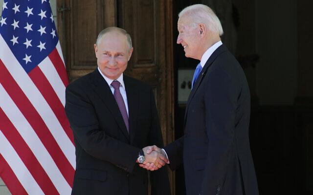 Russian President Vladimir Putin, left, and US President Joe Biden shake hands during their meeting at the 'Villa la Grange' in Geneva, Switzerland in Geneva, Switzerland, June 16, 2021. (AP Photo/Alexander Zemlianichenko, Pool)