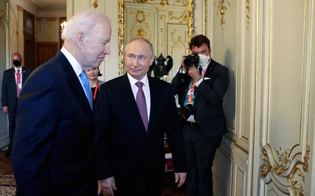 US President Joe Biden, left, and Russian President Vladimir Putin walk in a hall during their meeting at the 'Villa la Grange' in Geneva, Switzerland, June 16, 2021. (Mikhail Metzel/Pool Photo via AP)
