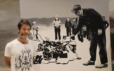 Polish artist Wilhelm Sasnal poses in front of one of his art works on display in a new exhibition at the POLIN Museum of the History of Polish Jews, in Warsaw, Poland, on June 15, 2021. (Czarek Sokolowski/AP)