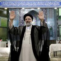 Ebrahim Raisi, who went on to win Iran's presidential elections, waves after casting his vote at a polling station in Tehran, Iran, June 18, 2021. (Ebrahim Noroozi/AP)