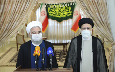 President Hassan Rouhani, left, speaks with the media after his meeting with President-elect Ebrahim Raisi, right, who is current judiciary chief, in Tehran, Iran, June 19, 2021. (Official Website of the Office of the Iranian Presidency Office via AP)