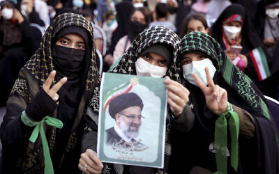 Supporters of Iranian president-elect Ebrahim Raisi celebrate after he won the presidential election in Tehran, Iran, June 19, 2021. (AP Photo/Ebrahim Noroozi)