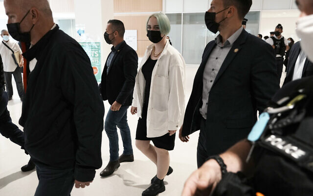 The teenager identifying herself online as Mila, center right, leaves the courtroom on Monday, June 21, 2021 in Paris. (AP Photo/Thibault Camus)