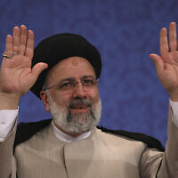 Iran's new President-elect Ebrahim Raisi waves to participants at the conclusion of his press conference in Tehran, Iran, June 21, 2021. (Vahid Salemi/AP)