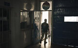 A Palestinian employee walks at the Pepsi bottling plant in Gaza City, June 21, 2021. (AP Photo/Felipe Dana)