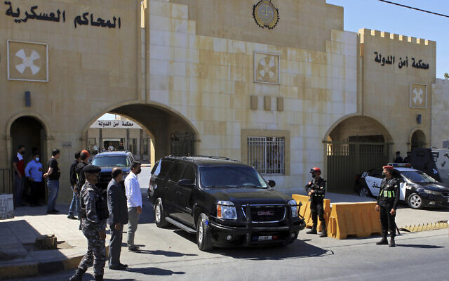 Bassem Awadallah, a former royal adviser, leaves a state security court in a vehicle after the first session of his trial, in Amman, Jordan, June 21, 2021. (AP Photo/Raad Adayleh)