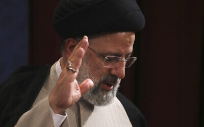Iran's new President-elect Ebrahim Raisi waves at the conclusion of his news conference in Tehran, Iran, June 21, 2021. (Vahid Salemi/AP)