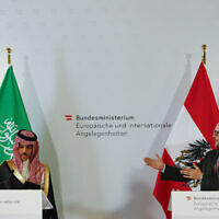 Saudi Foreign Minister Prince Faisal bin Farhan Al Saud, left, and the Austrian Foreign Minister Alexander Schallenberg speak during a news conference about the results of their bilateral meeting in Vienna, Austria, Tuesday, June 22, 2021. (AP Photo/Lisa Leutner)