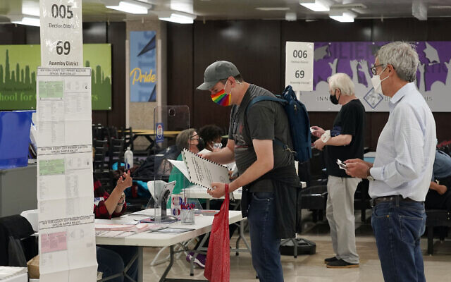 Voters receive their ballots at Frank McCourt High School, in New York, Tuesday, June 22, 2021. (AP/Richard Drew)