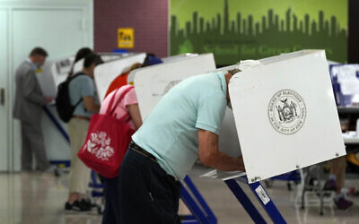 Voters mark their ballots at Frank McCourt High School, in New York, Tuesday, June 22, 2021. The final votes are set to be cast Tuesday in New York's party primaries, where mayors, prosecutors, judges and city and county legislators will be on the ballot, along with other municipal offices. (AP Photo/Richard Drew)