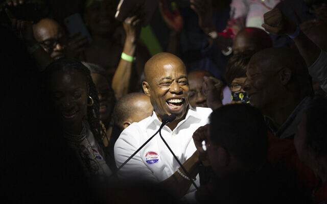 New York City Mayoral candidate Eric Adams mingles with supporters during his election night party, June 22, 2021, in New York. (Kevin Hagen/AP)