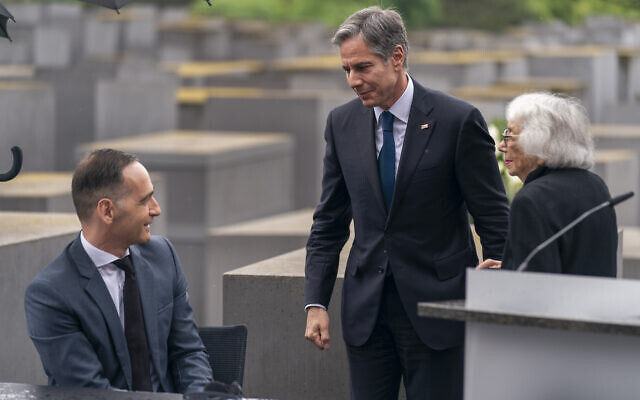 Holocaust Survivor Margot Friedlander, right, is greeted by US Secretary of State Antony Blinken, center, and German Minister of Foreign Affairs Heiko Maas, left, after speaking at a ceremony for the launch of a US-Germany Dialogue on Holocaust Issues at the Memorial to the Murdered Jews of Europe in Berlin, June 24, 2021. (AP Photo/Andrew Harnik, Pool)