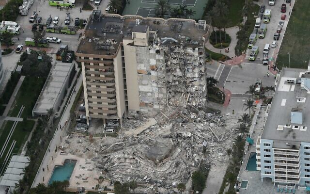 This aerial photo shows part of the 12-story oceanfront Champlain Towers South Condo that collapsed on early June 24, 2021, in Surfside, Florida.  (Amy Beth Bennett/South Florida Sun-Sentinel via AP)