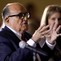In this November 25, 2020 file photo, former Mayor of New York Rudy Giuliani, a lawyer for President Donald Trump, speaks at a hearing of the Pennsylvania State Senate Majority Policy Committee in Gettysburg, Pennsylvania. (AP/Julio Cortez, File)
