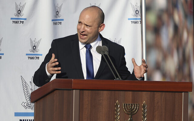 Prime Minister Naftali Bennett speaks at a graduation ceremony for new Israeli Air Force pilots at the Hatzerim airbase in southern Israel, June 24, 2021. (AP Photo/Ariel Schalit)