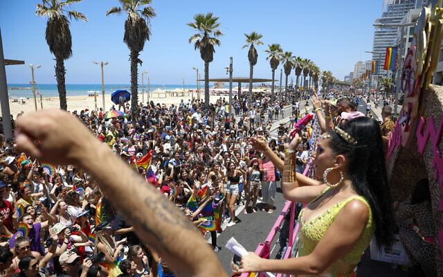 People participate in the annual Pride Parade, in Tel Aviv, Israel, Friday, June 25, 2021. (AP Photo/Ariel Schalit)