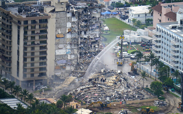 Rescue personnel work at the remains of the Champlain Towers South Condo in Surfside, Florida, on June 25, 2021. (AP Photo/Gerald Herbert)