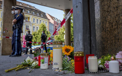 Flowers and candles laid at the scene of a deadly stabbing in central Wuerzburg, Germany, June 26, 2021. (Michael Probst/AP)